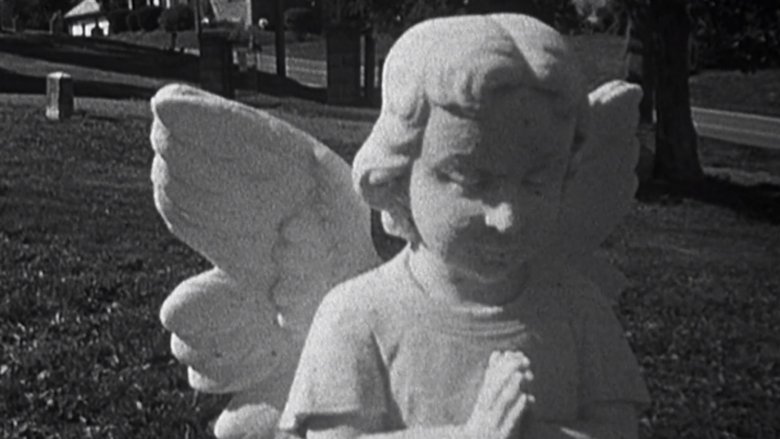 A stone angel at a child's grave site