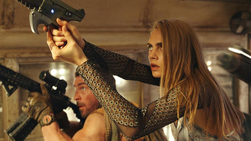 Sergeant Laureline holding a gun