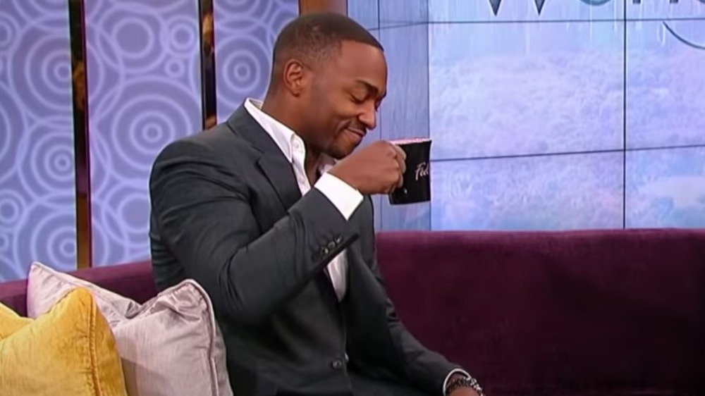 Anthony Mackie sipping drink