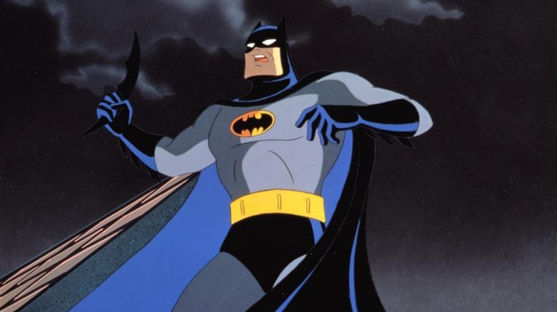Batman holding weapon