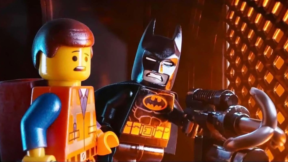 Emmet and Batman with his grappling hook