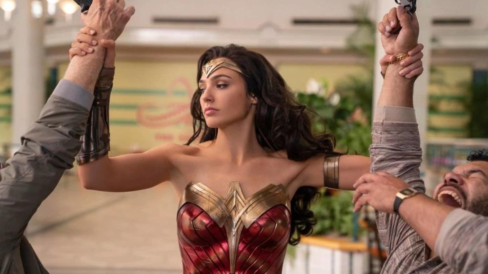 Wonder Woman casually grabbing gunmen by the wrist
