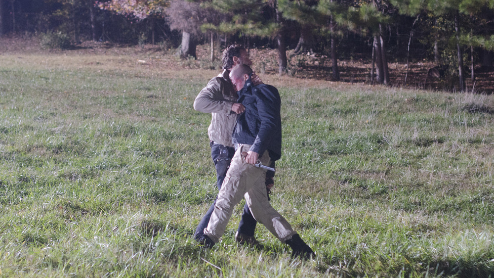 Andrew Lincoln as Rick Grimes, grappling with Jon Bernthal as Shane Walsh on The Walking Dead