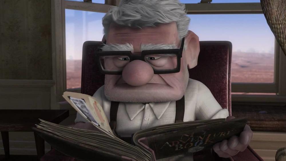 Carl looking at photo album