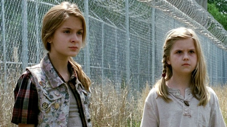 Brighton Sharbino as Lizzie Samuels and Kyla Kenedy as Mika Samuels on The Walking Dead