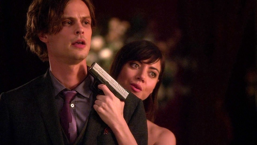 Cat Adams holding Spencer Reid at gunpoint on Criminal Minds