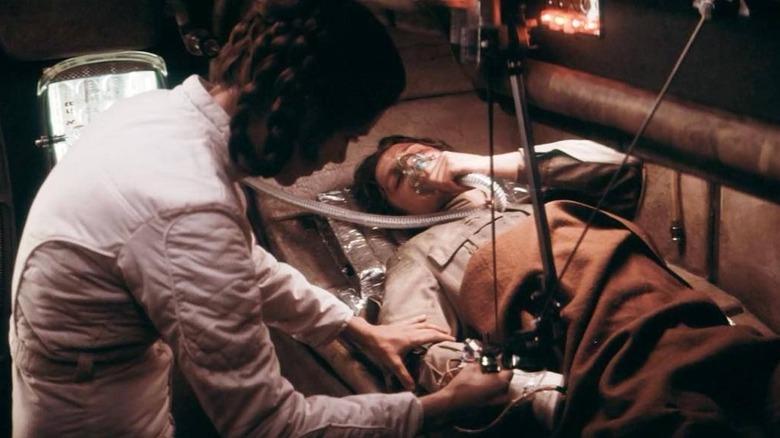 Leia Organa tending to Luke Skywalker
