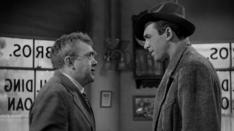 Thomas Mitchell as Uncle Billy and Jimmy Stewart as George in It's a Wonderful Life