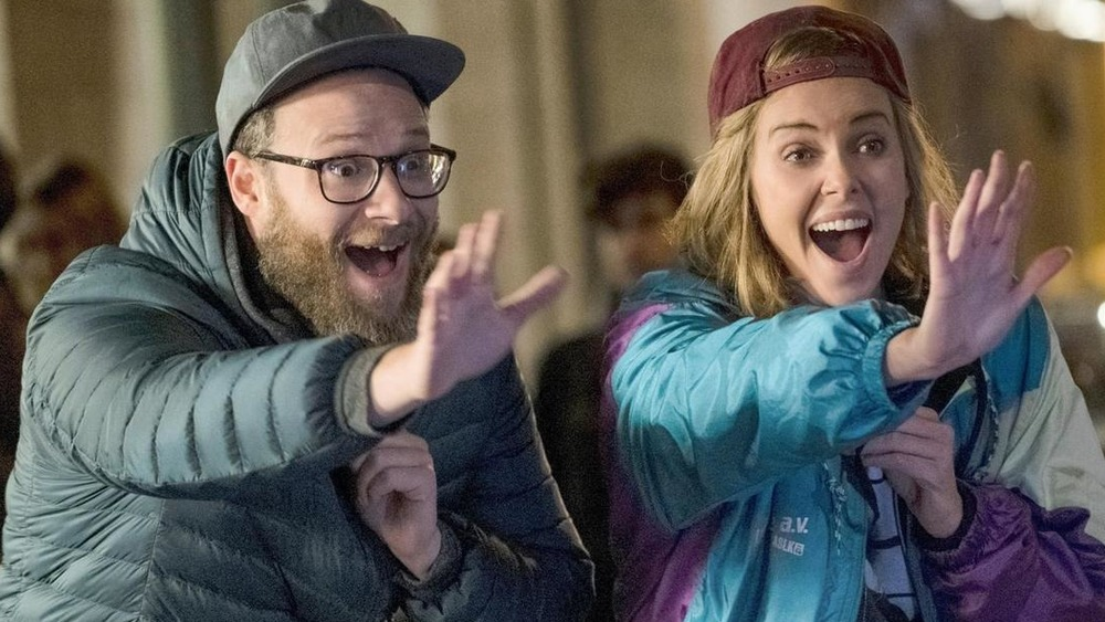 Seth Rogen and Charlize Theron laughing